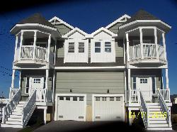 101 EAST 9TH AVENUE EAST - NORTH WILDWOOD RENTAL at WILDWOODRENTS.COM by ISLAND REALTY GROUP, NORTH WILDWOOD REALTORS - Spectacular brand new sundrenched 4 bedroom 3.5 bath townhouse located in North Wildwood is sure to make your stay a memorable and comfortable one! This fine home is located within walking distance to everything and offers a spacious living room, large dining area and gourmet kitchen. There is a fenced-in rear yard with covered deck off the living room. The second floor boats 4 bedrooms of which 2 are master suites with the front offering a covered balcony. Kitchen includes range, fridge, ice maker, disposal, dishwasher, microwave, coffeemaker, toaster, and blender. Sleeps 10; 3 queen, 2 full. Amenities include central a/c, washer/dryer, outside shower, gas grill, and 2 car off street parking. Make your reservation today as this property will not last long!