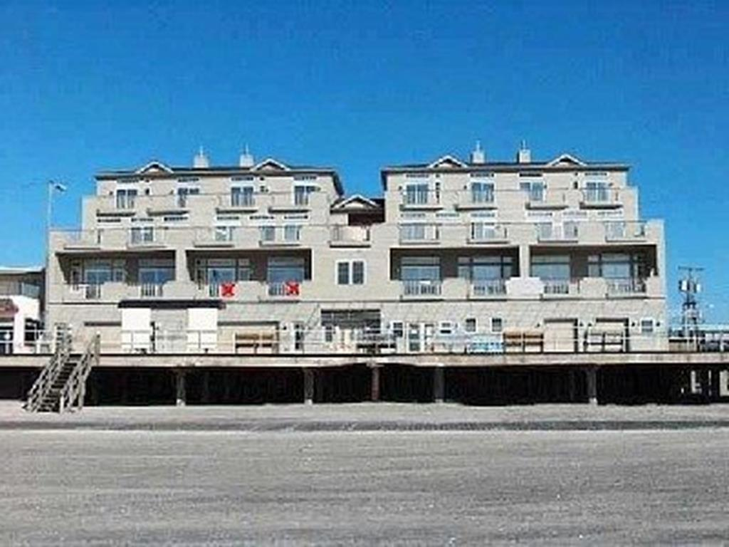 1600 BOARDWALK #203 - NORTH WILDWOOD BOARDWALK & BEACHFRONT SUMMER VACTION RENTALS - Absolutely the most Magnificent panoramic Beach, Ocean and Sunrise views you'll see!!! 4 Bedroom 3 Bath Condominium located directly on the Boardwalk in North Wildwood. In addition to the location and views this complex offers an elevator, 2 car garage parking and private decks to take in all there is to enjoy at the shore. Home is fully equipped with a full kitchen, central HVAC, High Speed Internet/WiFi and private washer and dryer. Sleeps 10; 3 Queens, 2 Singles, 1 Queen Sofa Bed. North Wildwood Rentals, Wildwood Rentals, Wildwood Crest Rentals and Diamond Beach Rentals in all price ranges for weekly, monthly, seasonal and weekend vacation rentals plus Wildwood real estate sales of homes, condos, vacation and investment properties in and around Wildwood New Jersey. We offer over 400 properties plus exclusive vacation homes so you can book the shore rental of your choice online and guarantee your vacation at the Shore. Rent with confidence at Island Realty Group! Visit www.wildwoodrents.com to book online or call our office at 609.522.4999. Our office at 1701 New Jersey Avenue in North Wildwood is open 7 days a week!
