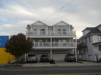 1703 SURF AVENUE, #100 - NORTH WILDWOOD RENTALS - Four bedroom, 3 bath vacation home located 2 blocks from the beach in North Wildwood! Home offers a full kitchen with range, fridge, dishwasher, microwave, icemaker, disposal, coffee maker and toaster. Amenities include: wifi, outside shower, balcony, central a/c, washer and dryer. Sleeps 9; 3 queen, and full/twin bunk.  North Wildwood Rentals, Wildwood Rentals, Wildwood Crest Rentals and Diamond Beach Rentals in all price ranges for weekly, monthly, seasonal and weekend vacation rentals plus Wildwood real estate sales of homes, condos, vacation and investment properties in and around Wildwood New Jersey. We offer over 400 properties plus exclusive vacation homes so you can book the shore rental of your choice online and guarantee your vacation at the Shore. Rent with confidence at Island Realty Group!