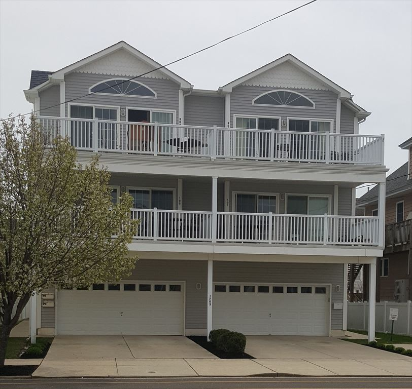 1703 SURF AVENUE, #101 - NORTH WILDWOOD RENTALS - Four bedroom, 3 bath vacation home located 2 blocks from the beach in North Wildwood! Home offers a full kitchen with range, fridge, dishwasher, microwave, icemaker, disposal, coffee maker and toaster. Amenities include: wifi, outside shower, balcony, central a/c, washer and dryer, 2 car off street parking. Sleeps 10; king, 2 full, 2 queen.  North Wildwood Rentals, Wildwood Rentals, Wildwood Crest Rentals and Diamond Beach Rentals in all price ranges for weekly, monthly, seasonal and weekend vacation rentals plus Wildwood real estate sales of homes, condos, vacation and investment properties in and around Wildwood New Jersey. We offer over 400 properties plus exclusive vacation homes so you can book the shore rental of your choice online and guarantee your vacation at the Shore. Rent with confidence at Island Realty Group!