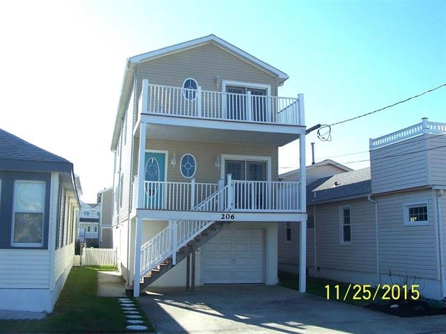 206 WEST 11TH AVENUE ON NORTH WILDWOOD'S BAYSIDE - 2 FAMILY NORTH WILDWOOD VACATION RENTAL - 2 Homes in one complete with 2 kitchens, 2 laundries, 2 garages, 2 outdoor showers, 7 TV's and the list goes on. All said and done 7 bedrooms 4 baths sleeps 18. 1 Queen, 2 Queen sleep sofas, 4 Doubles and 4 Singles.