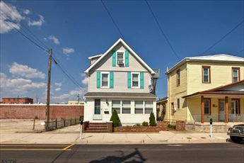 209 East Garfield Avenue in Wildwood - Two bedroom,, one bath cottage located 2.5 blocks from the beach/boardwalk. Sleeps 6;queen, 2 twin, futon sleep sofa. Kitchen includes range, fridge, microwave, toaster, coffeemaker. Amenities include 3 window a/c units, shared laundry, wifi. Shared outside shower and shared gas grill are complimented by two picnic benches in rear yard. Off street parking option may be available for a fee.