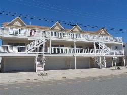 225 EAST DAVIS AVENUE UNIT E - WILDWOOD SUMMER VACATION RENTAL - Three bedroom, two bath vacation home close to the beach and boards in Wildwood. Kitchen has range, fridge, microwave, disposal, dishwasher, blender and toaster. Amenities include central a/c, washer/dryer, balcony, 3 car off street parking, wireless internet and local phone. Sleeps 8; 2 Queens, 3 Singles, 1 Bunk, 1 Queen Sofa Bed. Wildwood Rentals, North Wildwood Rentals, Wildwood Crest Rentals and Diamond Beach Rentals in all price ranges for weekly, monthly, seasonal and weekend vacation rentals plus Wildwood real estate sales of homes, condos, vacation and investment properties in and around Wildwood New Jersey. We offer over 400 properties plus exclusive vacation homes so you can book the shore rental of your choice online and guarantee your vacation at the Shore. Rent with confidence at Island Realty Group!