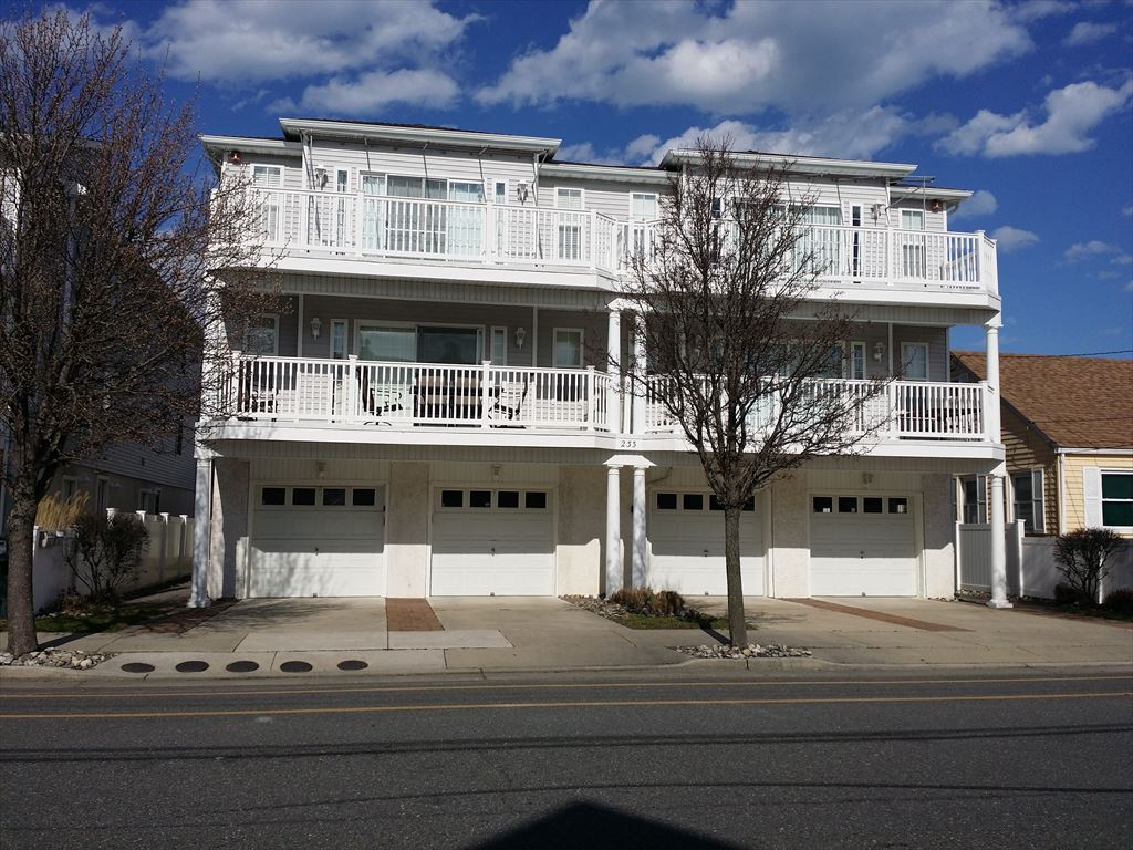 233 EAST ROBERTS AVENUE UNIT A IN WILDWOOD NEW JERSEY is a 3 bedroom 2 bath condominium that has never been rented. In excellent condition this is sure to make your family's summer vacation comfortable. Full kitchen, open living room and expansive deck.