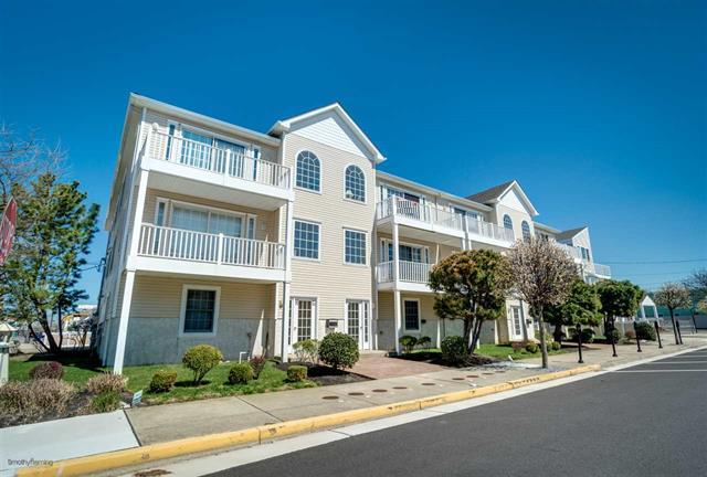301 EAST LEAMING AVENUE UNIT F - WILDWOOD SUMMER VACATION RENTALS - Three bedroom, two bath vacation home located one short block to the beach and boardwalk on the border of Wildwood Crest. Home offers a full kitchen with range, fridge, dishwasher, disposal, microwave, coffeemaker, toaster and blender. Amenities include central a/c, washer/dryer, wifi, balcony, and 2 car off street parking. Sleeps 8; king, queen, 2 twin and queen sleep sofa. Wildwood Rentals, North Wildwood Rentals, Wildwood Crest Rentals and Diamond Beach Rentals in all price ranges for weekly, monthly, seasonal and weekend vacation rentals plus Wildwood real estate sales of homes, condos, vacation and investment properties in and around Wildwood New Jersey. We offer over 400 properties plus exclusive vacation homes so you can book the shore rental of your choice online and guarantee your vacation at the Shore. Rent with confidence at Island Realty Group!