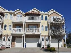 333 EAST 11TH AVENUE #200 - NORTH WILDWOOD SUMMER VACATION RENTALS - Three bedroom, two bath vacation home located 1.5 blocks from the beach. Home offers a full kitchen with range, fridge, icemaker, dishwasher, disposal, coffeemaker, microwave, blender, toaster. Amenities include central a/c, washer/dryer, balcony, outside shower, and two car off street parking. Sleeping; queen, 3 full, 5 twin. Max occupancy 10 including children. North Wildwood Rentals, Wildwood Rentals, Wildwood Crest Rentals and Diamond Beach Rentals in all price ranges for weekly, monthly, seasonal and weekend vacation rentals plus Wildwood real estate sales of homes, condos, vacation and investment properties in and around Wildwood New Jersey. We offer over 400 properties plus exclusive vacation homes so you can book the shore rental of your choice online and guarantee your vacation at the Shore. Rent with confidence at Island Realty Group!