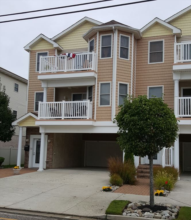 407 EAST 22ND AVENUE UNIT 100 - BEACHBLOCK IN NORTH WILDWOOD - Beach and boardwalk block! Four bedroom, three bath, with a full kitchen with range, fridge, dishwasher, disposal, microwave, blender, coffeemaker and toaster. Amenities include central a/c, washer/dryer, balcony, off street parking, wifi. Main floor offers 3 bedrooms, two baths and large great room with kitchen, dining and living areas. Sleeps 8, 1 King and 3 Queens.  Wildwood Rentals, North Wildwood Rentals, Wildwood Crest Rentals and Diamond Beach Rentals in all price ranges for weekly, monthly, seasonal and weekend vacation rentals plus Wildwood real estate sales of homes, condos, vacation and investment properties in and around Wildwood New Jersey. We offer over 400 properties plus exclusive vacation homes so you can book the shore rental of your choice online and guarantee your vacation at the Shore. Rent with confidence at Island Realty Group!