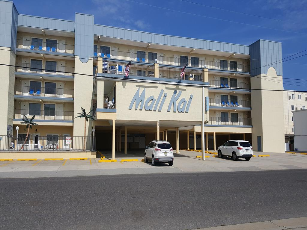 417 EAST 19TH AVENUE - MALI KAI #202 - NORTH WILDWOOD SUMMER VACATION RENTALS with POOLS - One bedroom, one bath condo located at the Mali Kai in North Wildwood. Unit offers a kitchen with range, fridge, microwave, blender, toaster and coffeemaker. Amenities include central a/c, Heated Adult and Children's pool, expansive outdoor dining areas with gas Barbecues, elevator, wifi, on-site coin-op laundry and 1 car off street parking. Sleeps 6; 2 queen and full sleep sofa. Beach block location! North Wildwood Rentals, Wildwood Rentals, Wildwood Crest Rentals and Diamond Beach Rentals in all price ranges for weekly, monthly, seasonal and weekend vacation rentals plus Wildwood real estate sales of homes, condos, vacation and investment properties in and around Wildwood New Jersey. We offer over 400 properties plus exclusive vacation homes so you can book the shore rental of your choice online and guarantee your vacation at the Shore. Rent with confidence at Island Realty Group!