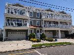 419 EAST 21ST AVENUE #201 - SANS SOUCI CONDOMINIUMS LOCATED BEACHBLOCK IN NORTH WILDWOOD! Beach block with ocean views and pool in North Wildwood. This rental is on a Sunday to Sunday rental schedule. Four bedroom /two bath home has a spacious floor plan with a spiral staircase leading to the 4th bedroom in the loft. Full kitchen has fridge, range, dishwasher, microwave, disposal, coffeemaker and toaster. Amenities include 2 balconies with ocean view, 1 balcony with pool view, pool, central a/c, washer/dryer, wifi, and 2 car off street parking. Sleeps 14; 5 queen, twin/twin bunk, and full futon. North Wildwood Rentals, Wildwood Rentals, Wildwood Crest Rentals and Diamond Beach Rentals in all price ranges for weekly, monthly, seasonal and weekend vacation rentals plus Wildwood real estate sales of homes, condos, vacation and investment properties in and around Wildwood New Jersey. We offer over 400 properties plus exclusive vacation homes so you can book the shore rental of your choice online and guarantee your vacation at the Shore. Rent with confidence at Island Realty Group! Visit www.wildwoodrents.com to book online or call our office at 609.522.4999. Our office at 1701 New Jersey Avenue in North Wildwood is open 7 days a week!