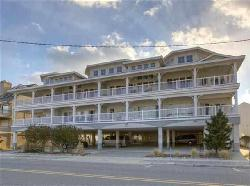 420 EAST 2ND AVENUE UNIT E - BEACHFRONT IN NORTH WILDWOOD - OCEANFRONT! Previously owner occupied and never rented! Top floor three bedroom, three bath vacation home. Looking for something with luxury with a view? This home has it all! View bi-weekly concerts from the balcony, watch your family on the beach, tremendous ocean and inlet views. Views from the kitchen, dining, and living room, as well as views and deck access from one of the 2 master bedrooms. Large balcony offers lots of seating for the family. Home offers a full kitchen with range, fridge, dishwasher, microwave, icemaker, disposal, toaster, coffeemaker, and blender. Sleeps 8: 2 queen, 2 twin and queen sleep sofa. Amenities include TV's in all rooms, wifi, central a/c, washer/dryer with soak/rinse sink, outside shower, beach gear storage, and two car off street assigned parking. Master suites include walk in showers in both, and Jacuzzi tub in one. The decor is nautical themed, and magazine-worthy. Rent with confidence at Island Realty Group!