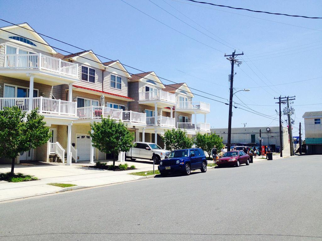 429 EAST 25TH AVENUE - BEACH REST CONDOMINIUMS UNIT 101 IN NORTH WILDWOOD - Five bedroom, three bath vacation home located steps from the beach and boardwalk in North Wildwood. First floor offers handicapped accessible living space. No steps to enter the unit. Use the handicapped ramp (as pictured) to enter the bottom level with 2 bedrooms plus BONUS family room. One of the ground level bedrooms also has its own bathroom with handicap accessible shower. There is a washer and dryer on this level for your private use on this level. The second floor offers an open kitchen, full hallway bath, 3 additional bedrooms, and dining/ living room with a queen sleeper sofa-bed. This area boasts a private patio (facing 25th Ave.) Enjoy a fully equipped kitchen with all appliances and amenities –refrigerator/freezer, dishwasher, built-in microwave, self-cleaning oven, toaster, blender, coffee maker, dishes and glassware, pots, pans, etc. - Bedroom 1 Lower level Master suite- 1Queen and 1 twin bed with a private handicap accessible bathroom. (sleeps 3) - Bedroom 2 Lower level- 1 Queen poster bed. (sleeps 2) Upstairs bedrooms: - Master Bedroom: 1 King size bed with TV and private full-size bathroom -- (sleeps 2) The master bedroom also has a large walk-in closet.  - Bedroom 3: 1 Queen and 1 twin sized beds -- (sleeps 3) - Bedroom 4: 1 Full bed with 1 twin trundle (sleeps 3)  - Upper Family room has 2 pull out queen sofa beds for the flexible sleeping arrangement– (sleeps 4) Amenities include central a/c, washer/dryer, wifi, balcony, and off street parking. North Wildwood Rentals, Wildwood Rentals, Wildwood Crest Rentals and Diamond Beach Rentals in all price ranges for weekly, monthly, seasonal and weekend vacation rentals plus Wildwood real estate sales of homes, condos, vacation and investment properties in and around Wildwood New Jersey. We offer over 400 properties plus exclusive vacation homes so you can book the shore rental of your choice online and guarantee your vacation at the Shore. Rent with confidence at Island Realty Group!