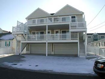 504 East 11th Avenue in North Wildwood - Three bedroom, two bath vacation home with ocean views. Home offers a full kitchen with range, fridge, icemaker, disposal, dishwasher, microwave, coffee maker and toaster. Amenities include central a/c, washer/dryer, wifi, balcony, outside shower, 1 car off-street parking & municipal parking permit for street parking of 2nd vehicle. Sleeps 9; king, queen, full/twin bunk, and full sleep sofa.