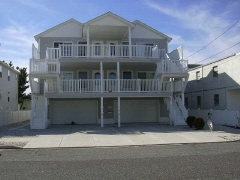 "506 EAST 7TH AVENUE ""D"" - NORTH WILDWOOD BEACHBLOCK SUMMER VACATION RENTAL - Three bedroom, two bath vacation home with beach views! Home offers a full kitchen with range, fridge, dishwasher, microwave, toaster and coffeemaker PLUS 3 DVD's, 4 color TV's, vacuum and WIFI. Sleeps 8; king, queen,2 twin, queen sofa bed. Additional amenities washer/dryer, central a/c, two car off street parking, outside shower. Tastefully decorated! North Wildwood Rentals, Wildwood Rentals, Wildwood Crest Rentals and Diamond Beach Rentals in all price ranges for weekly, monthly, seasonal and weekend vacation rentals plus Wildwood real estate sales of homes, condos, vacation and investment properties in and around Wildwood New Jersey. We offer over 400 properties plus exclusive vacation homes so you can book the shore rental of your choice online and guarantee your vacation at the Shore. Rent with confidence at Island Realty Group! Visit www.wildwoodrents.com to book online or call our office at 609.522.4999. Our office at 1701 New Jersey Avenue in North Wildwood is open 7 days a week!"